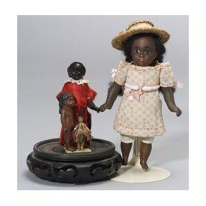 """Four Black """"Primitive"""" Cloth Dolls"""