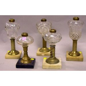 Five Assorted Colorless Pressed Glass and Brass Oil Lamps