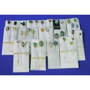 Thirty-five Mostly Gold, Hardstone, or Glass Mounted Stickpins