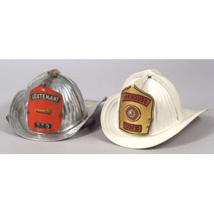 Two Metal Fire Helmets by Cairns & Brother