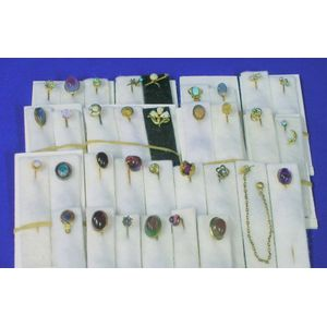 Thirty-four Mostly Gold, Tourmaline, and Opal Mounted Stickpins