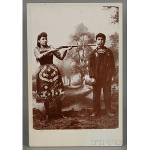 Cabinet Card Depicting a Female Sharpshooter, Possibly Annie Oakley