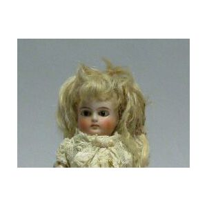 Small Closed Mouth Flange Neck Bisque Doll