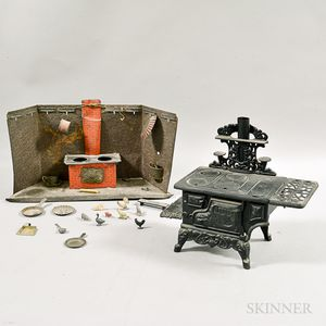 Crescent Cast Iron Toy Stove and a Pressed Tin Toy Stove.     Estimate $20-200