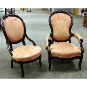 Two Victorian Rococo Revival Upholstered Carved Walnut Parlor Chairs.