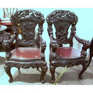 Pair of Asian Ebonized Carved Hardwood Armchairs.