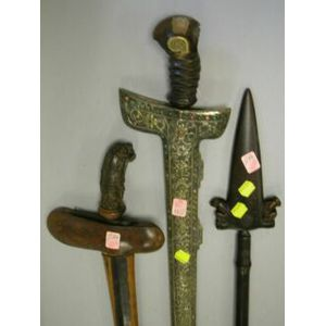 Two Indonesian Swords and a Point.