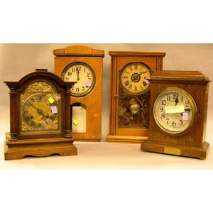 Swiss Oak Presentation Shelf Clock, a German Mahogany Bracket Clock, a Japanese Grained Wall Clock, and a Victorian Inlaid Oak Shelf Cl