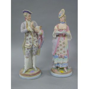 Bisque Figural Gentleman and Lady.