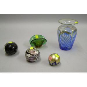Three Contemporary Art Glass Paperweights, a Small Bowl, and a Vase.