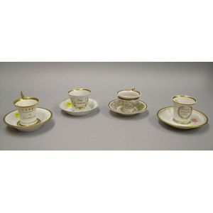 Four Assorted 19th Century KPM and KPM-type Gilt Porcelain Cups and Saucers.