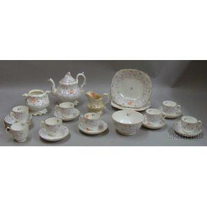Twenty-four Piece English Hand-painted Porcelain Partial Tea Service.