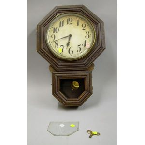 E. Ingraham 10 in. Ingot, Oak Cased Drop Octagon Wall Clock