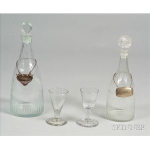 Two Early Blown Molded Colorless Glass Decanters with Two Wines