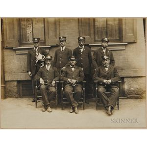 Photograph of African American Porters in Uniform.     Estimate $500-700