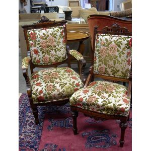 Two Renaissance Revival Upholstered Carved Walnut Parlor Chairs.