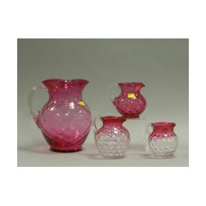 Four Cranberry Glass Pitchers.