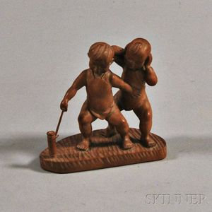 Wood Carving of Two Boys