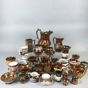 Thirty-two Pieces of Copper Lustre Ceramic Tableware.     Estimate $20-200
