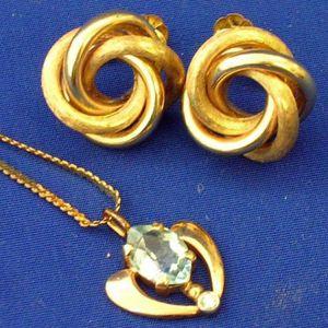 Gold Knot Earrings and Aquamarine Pendant.