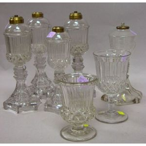 Five Sandwich Colorless Pressed Glass Oil Lamps and Two Spill Holders