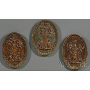 Three Oval Format Carved Wood Panels