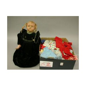 Doll and Lot of Doll Clothes.