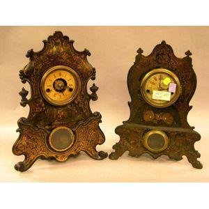 Two Victorian Rococo Revival Gilt Decorated Cast Iron Mantel Clocks.
