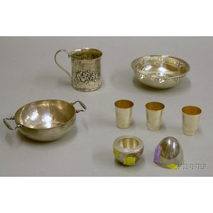 Four Pieces of Silver Drinking and Serving Items