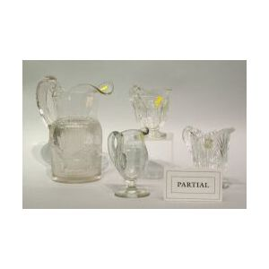 Fifteen Assorted Colorless Pattern Glass Creamers and a Pitcher.