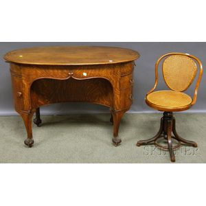 Early 20th Century Oval Carved Oak Flat-top Writing Desk and Bentwood Caned   Adjustable Swivel Chair