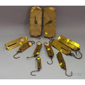 Ten Brass Hanging Scales.