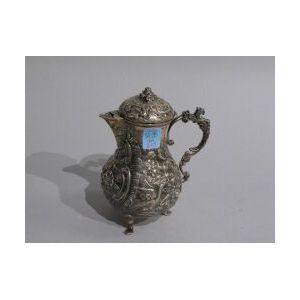 Rococo-style Sterling Silver Repousse Demitasse Pot.