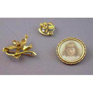 Hand-painted Portrait Pin and Two Art Nouveau Floriform Pins.