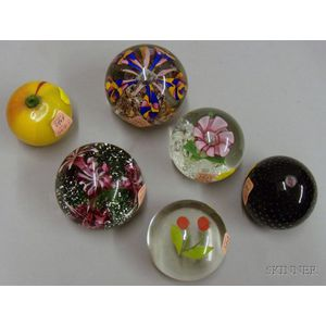Five Internally Decorated Paperweights and a Glass Peach
