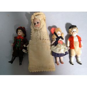 Three Small All-Bisque Dolls and a Baby in Swaddling Clothes