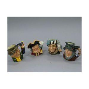 Four Royal Doulton Toby Jugs