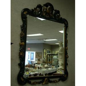 Rococo-style Carved Gilt and Ebonized Wood Framed Mirror.