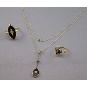Two Art Deco Gold, Diamond, and Onyx Rings and a Similar Pendant