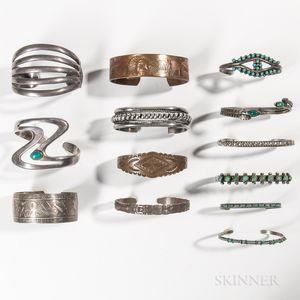 Twelve Southwest and Northwest Coast Silver Band Bracelets