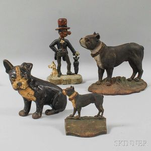 Three Polychrome Cast Iron Dog Doorstops and a Bookend
