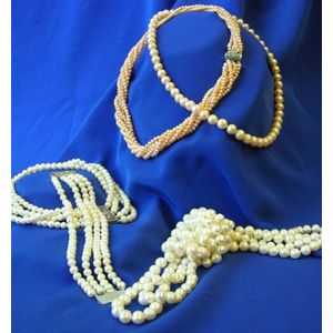 Four Strands of Cultured Pearls and a Bracelet.