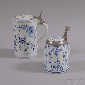 Two Blue and White Ceramic Steins