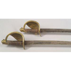 Two Naval Cutlasses