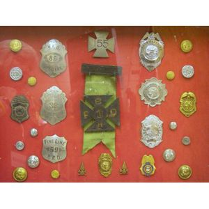 Framed Group of Twenty-nine Firefighting Badges, Buttons and Pins
