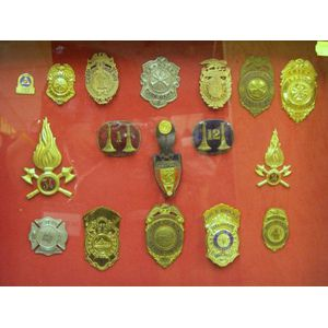 Framed Group of Seventeen Firefighting Badges and Buttons