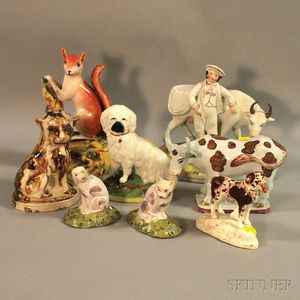 Eight Assorted Staffordshire and Faience Ceramic Figures and Figural Groups