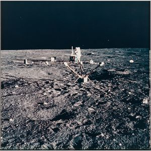 Apollo 12, Astronaut Charles Conrad Jr. Aligns the Antenna on the Central Station of the Apollo Lunar Surface Experiments Package...