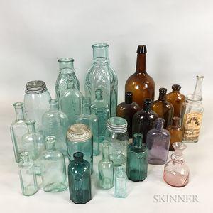 Twenty-six Colored Blown Glass Patent Medicine Bottles, Jars, and Flasks