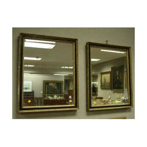 Pair of Parcel-gilt and Ebonized Mirrors
